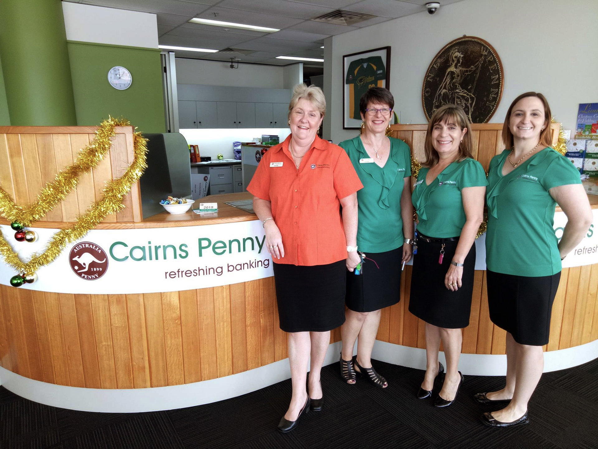 Cairns Bank employees posing inside the office