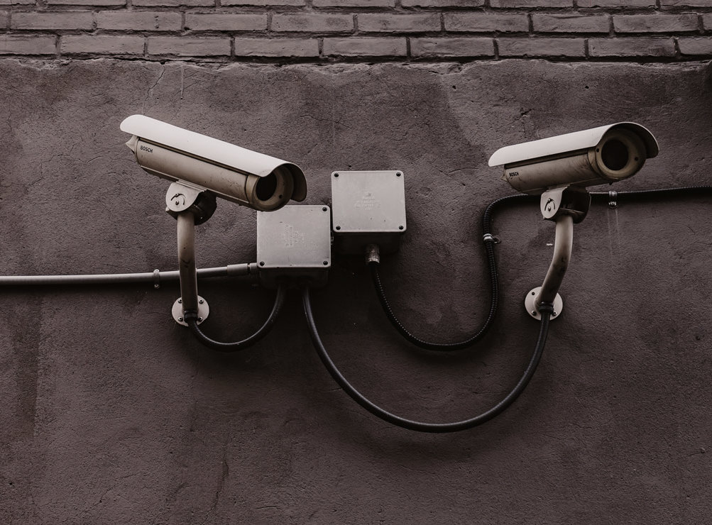 Bank security cameras on a grey wall